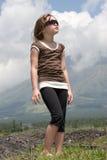 Girl near Mayon volcano Stock Photos