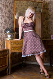 Girl near the mirror Stock Photography