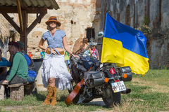 Girl near a motorcycle with a flag of Ukraine Royalty Free Stock Photos