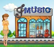 A girl near the music shop Stock Photos