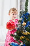 Girl  near a New Year tree Royalty Free Stock Photography