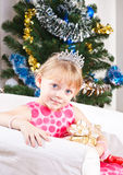 Girl  near a New Year tree Royalty Free Stock Photo