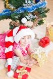 Girl  near a New Year tree Royalty Free Stock Photography