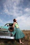 Girl near old car. At outdoor. Photo #1 Stock Photo