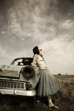 Girl near old car. Photo in vintage style #1 Stock Image
