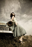 Girl near old car. Photo in vintage style #2 Stock Photography