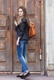 Girl near the old door Royalty Free Stock Photos