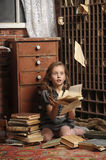 Girl in the old library Royalty Free Stock Images