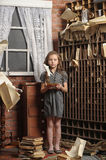 Girl in the old library Stock Photography