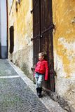 Girl near the old wall and door Royalty Free Stock Photography