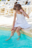 Girl near outdoor swimming pool Stock Photography