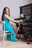 Girl near piano Stock Photo
