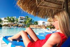 Girl near pool Stock Images