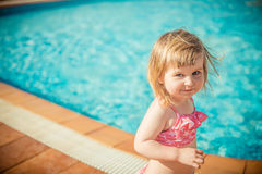Girl near the pool Royalty Free Stock Images