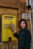 Girl near post. Of Vatican with letter royalty free stock photos