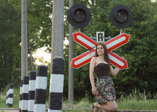 Girl near railroad's traffic sign Stock Photography
