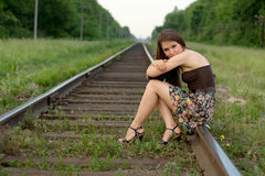 Girl near railroad's traffic sign Stock Image