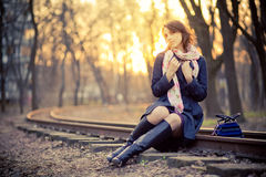 Girl near the railway at sunset Stock Photography