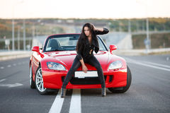 Girl near red car Stock Photography