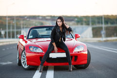 Girl near red car Royalty Free Stock Photography