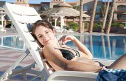 Girl near resort swimming pool Royalty Free Stock Images