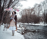 The girl near the river with the  floral umbrella Stock Photo