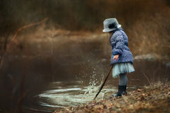 Girl  near river. At spring cloudy day Stock Image