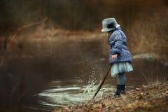 Girl  near river Stock Image