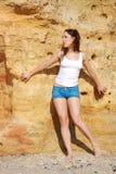 Girl near a rock Royalty Free Stock Photo