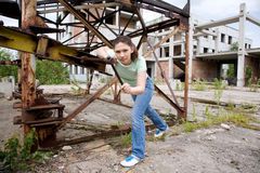 Girl near rust construction Royalty Free Stock Photo