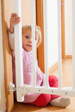 Girl near safety gate Stock Photography