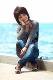 Girl near the sea Stock Photography