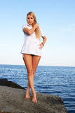 Girl near the sea Royalty Free Stock Photo