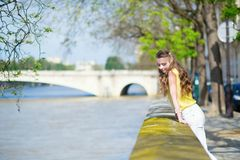 Girl near the Seine Royalty Free Stock Photography