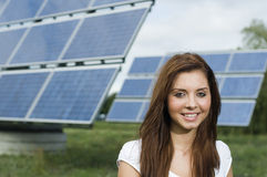 Girl near solar panels Royalty Free Stock Images