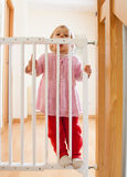 Girl near stair gate Royalty Free Stock Photography