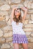 Girl near stone wall Stock Photo