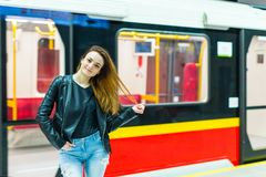 The girl near subway train Stock Images