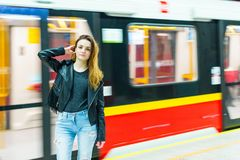 The girl near subway train Royalty Free Stock Images
