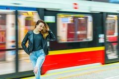 The girl near subway train Stock Image