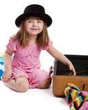 Girl near suitcase Stock Image