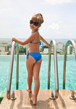 Girl near swimming pool Stock Photo