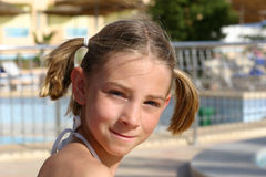 Girl near the swimming pool. Looking straight in the camera royalty free stock photo