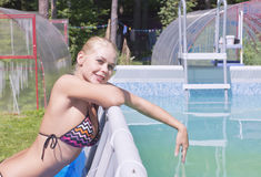 Girl near the swimming pool. Portrait of a young woman Royalty Free Stock Photography