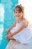 Girl near swimming-pool Stock Images