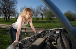 Free Girl Near The Car With An Open Hood. Stock Photos - 81118773