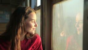 The girl near the train car window stock footage