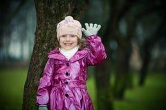 Girl near tree Stock Photos