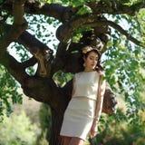 Girl near the tree Stock Photos