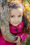 Girl near a tree in the park Stock Photo